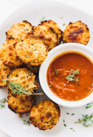 Cauliflower Pizza bites Surrounding Marinara sauce