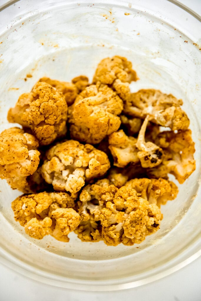 marinated cauliflower for vegan butter chicken in a clear glass bowl